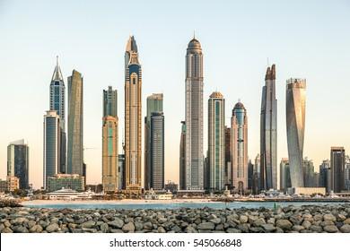 An overview of buildings in Dubai Marina as seen from Dubai Palm Jumeira.