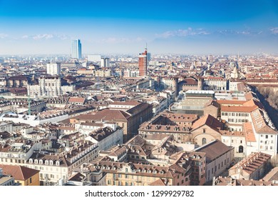 """Overview of the city of Turin, seen from the top of the """"Mole Antonelliana"""". Sunny day in winter with light atmospheric pollution."""