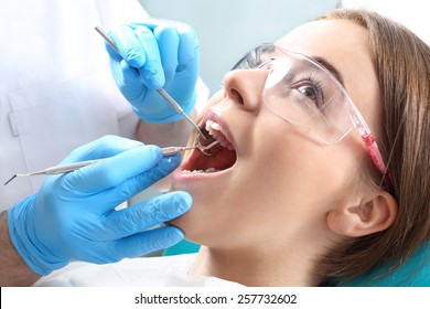 Overview of dental caries prevention.Woman at the dentist's chair during a dental procedure