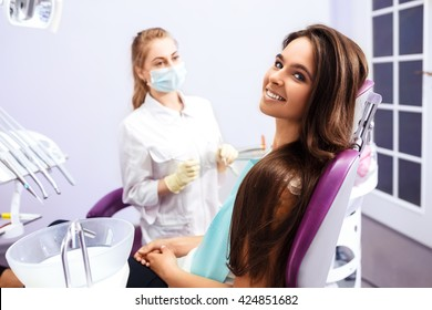 Overview of dental caries prevention.Woman at the dentist's chair during a dental procedure. Beautiful Woman smile close up. Healthy Smile. Beautiful Female Smile