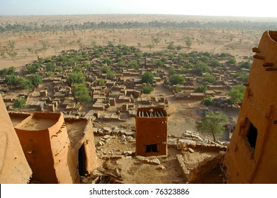 An overview of a Dogon village through mud dwellings in Mali