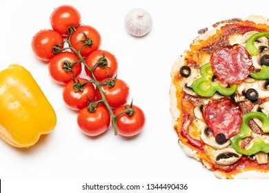 overview of a fresh pizza on white