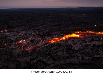 Overview of glowing lava flow from Puu Oo in the evening on the Pali in Kalapana, Big Island, Hawaii.