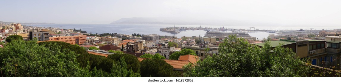 Overview of the harbor with cruise ship in Messina Sicily, Italy