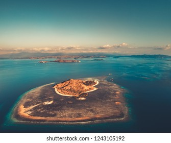 Overview island, ocean. Aerial drone shot. Komodo. Stunning panoramic view from above the one of the islands of Komodo National Park surrounded by the ocean. Indonesia. UNESCO World Heritage Site.