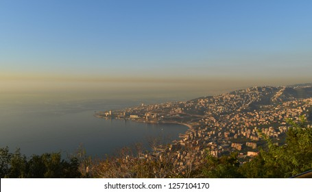 overview of lebanese coast with a thick cloud of athmospheric pollution. Jounieh and maameltein and tabarja heading on the mediterranean sea, Lebanon