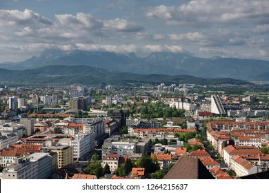 Overview of Ljubljana capital city of Slovenia with Mount Saint Mary and distant Kamnik Savinja Alps mountains from the hilltop Ljubljana Castle