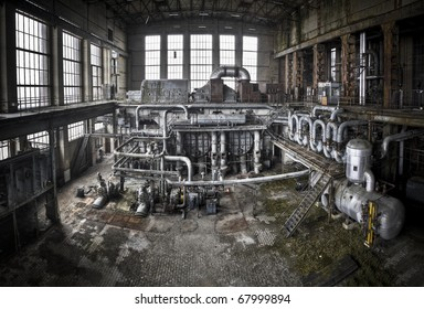 An overview of the main generator hall at an abandoned energy plant