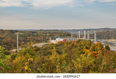 Overview of natural gas fracking pad near Moundsville West Virginia in the fall with autumn trees