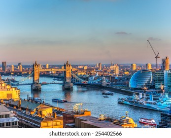 Overview of River Thames in Sunset in London. Tower Bridge and the City Hall in the Background