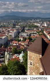 Overview of Saint Nicholas church Ljubljana Cathedral and Kamnik Savinja Alps mountains Slovenia from the hilltop Ljubljana Castle