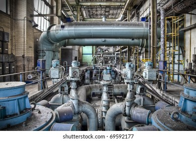 An overview of a sub level pipeline construction at an old abandoned factory, a maze of tube-lines creating a wonderful composition.