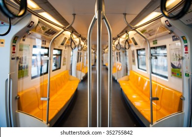 Overview of yellow seats in electric train, Public Transportation in Bangkok. Sky train / BTS elevated rails