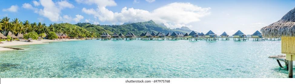 Overwater bungalow panorama in Bora Bora, French Polynesia.