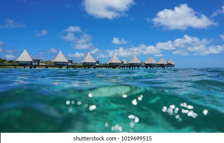 Overwater bungalows in the lagoon seen from sea surface, Maitre island, New Caledonia, south Pacific ocean, Oceania