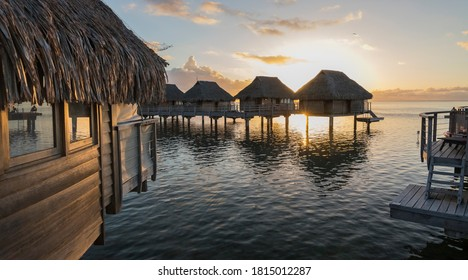 The Overwater Bungalows of Moorea at sunset.
