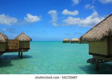 Overwater bungalows in Tahiti tropical paradise