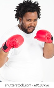 overweight african american man with boxing gloves