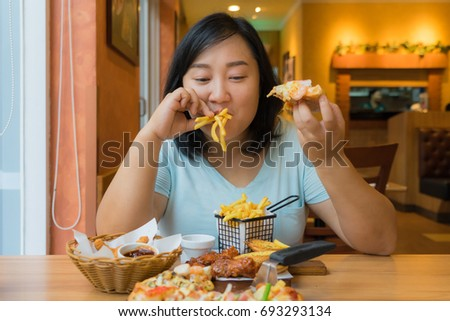 Overweight Asian Woman Is Eating Fast Foodfat Female Enjoy Unhealthy Foods