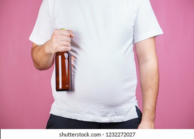 overweight, beer belly, alcohol party, alcoholic, addiction. Obese man with beer bottle. unhealthy lifestyle and bad habits