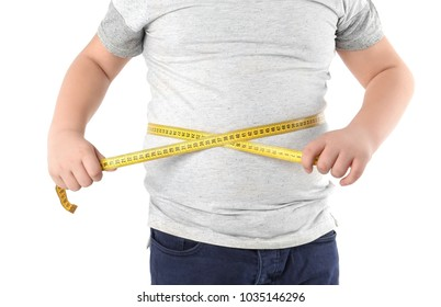 Overweight boy with measuring tape on white background