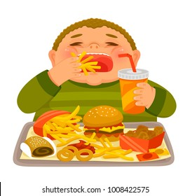 Overweight boy mindlessly eating junk food