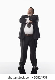 Overweight businessman standing with arms folded