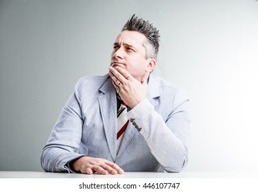 overweight businessman thinking about opportunities