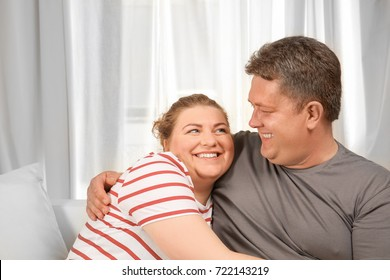 Overweight couple at home