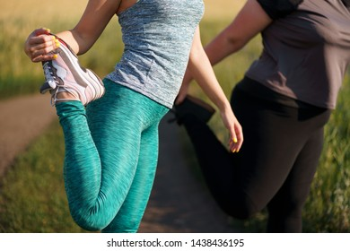 Overweight and fit women warming up before outdoor jogging. Two female friends getting ready for workout. Weight loss, motivation, sports, health care concept