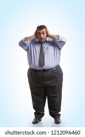 Overweight man in formal clothes holding his head with both hands with an expression of shock