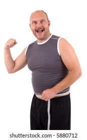 Overweight man looking very happy because he lost some pounds