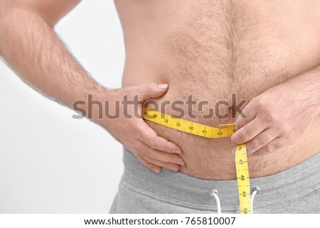 Overweight Man Measuring Tape On Light Stock Photo Edit Now