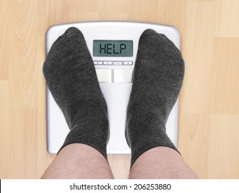 overweight man on personal scales
