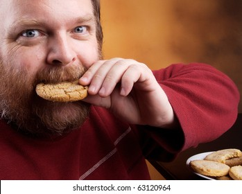 Overweight middle aged man with cookies