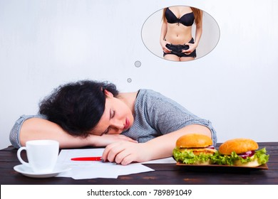 Overweight obese woman with junk food sleeping and dreaming of fit and slim body. Weight losing, obesity, high-calorie food, unhealthy nutrition,dieting concept