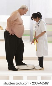 Overweight  senior man measuring his weight with doctor