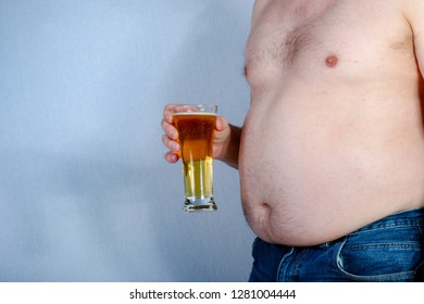 Overweight shirtless caucasian man holding a beer