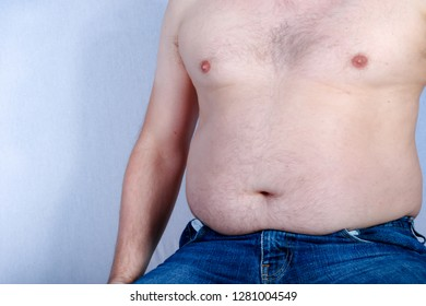 Overweight shirtless caucasian man sitting down