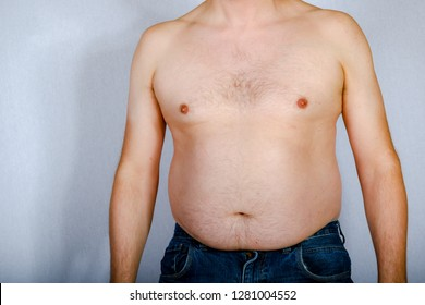 Overweight shirtless caucasian man standing up viewed from the front