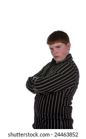 overweight teenage boy with arms crossed and an earring