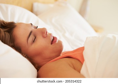 Overweight Woman Asleep In Bed Snoring