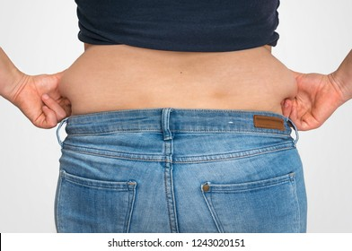 Overweight woman body with fat on belly - overweight and obesity concept