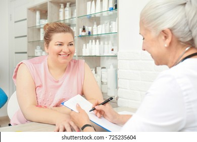 Overweight woman having consultation at doctor's office