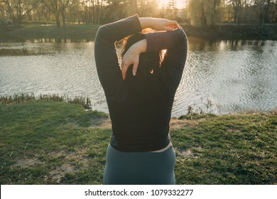 Overweight woman stretching hands relaxing while walking in the park. Healthy lifestyle, weight losing, activity concept