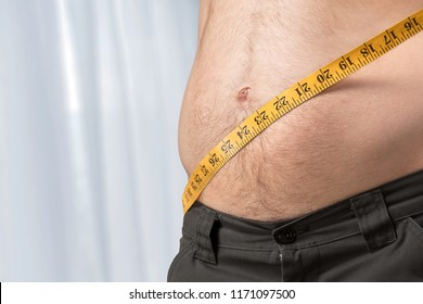 Overweight woman with tapemeasure