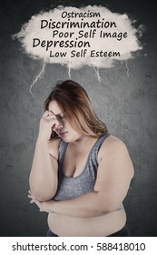 Overweight woman thinking her problems and looks stressful while wearing sportswear