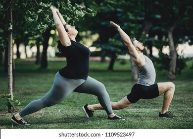 Overweight woman working out with personal trainer. Individual training outdoors. Fitness, sport, training, weight loss, teamwork and lifestyle concept.