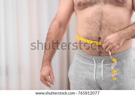 Overweight Young Man Measuring Tape Home Stock Photo Edit