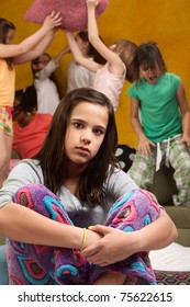 Overwhelmed babysitter with wild little girls at a sleepover